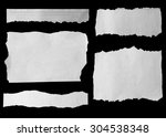 pieces of torn paper on black | Shutterstock . vector #304538348
