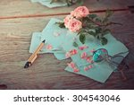 Pink rose on wooden table...