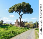 Small photo of On the ancient Via Appia, the Appian Way, in Rome, Italy.