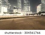 the light trails on the modern... | Shutterstock . vector #304561766