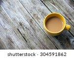 Yellow Coffee Mug On Rustic...