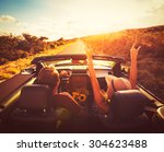 happy young couple driving... | Shutterstock . vector #304623488