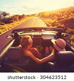 happy young couple driving... | Shutterstock . vector #304623512