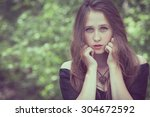 portrait of a beautiful young... | Shutterstock . vector #304672592