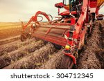 tractor plowing up the field. | Shutterstock . vector #304712345