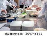Team Of Restaurant Chef Helpin...