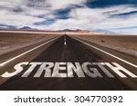 strength written on desert road | Shutterstock . vector #304770392