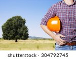 the builder hold  a helmet in... | Shutterstock . vector #304792745