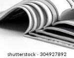 stack of magazines on white... | Shutterstock . vector #304927892