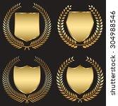 golden shield with laurel wreath | Shutterstock .eps vector #304988546