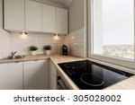 Stock photo image of functional light kitchen in new flat 305028002