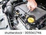 hands repairing a car engine...   Shutterstock . vector #305061746