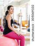 woman doing pilates exercises... | Shutterstock . vector #305069102