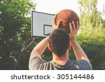 Basketball Player On A Outdoor...