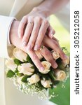Bride And Groom\'s Hands With...