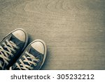 old worn sneakers on a...   Shutterstock . vector #305232212