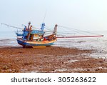 Fishing Boats Moored At Low...
