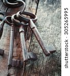Old Rusty Keys On Wooden...
