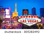 Stock photo welcome to fabulous las vegas nevada sign with blur strip road background 305282492