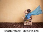 happy child playing in... | Shutterstock . vector #305346128
