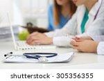 medicine doctor's working table.... | Shutterstock . vector #305356355