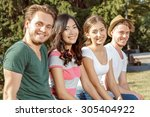 four students smiling warmly... | Shutterstock . vector #305404922