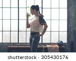 standing in profile  a woman... | Shutterstock . vector #305430176