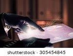 close up of human hands using...   Shutterstock . vector #305454845