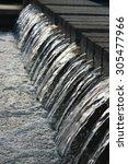 a little waterfall in a park on ... | Shutterstock . vector #305477966