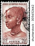 Small photo of SAINT-PETERSBURG, RUSSIA - AUGUST 10, 2015: A stamp printed by FRENCH WEST AFRICA shows image portrait of Agni Woman from Ivory Coast, circa March, 1947.
