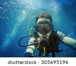 scuba diver man swimming on a... | Shutterstock . vector #305695196