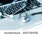 stethoscope on laptop keyboard | Shutterstock . vector #305759558
