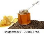 honey in the comb on an... | Shutterstock . vector #305816756