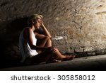 lonely young woman sitting on...   Shutterstock . vector #305858012