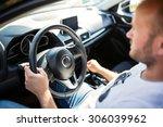 man driving a car | Shutterstock . vector #306039962