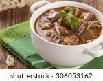 beef stew served with bread in...   Shutterstock . vector #306053162