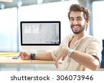 young man working on computer | Shutterstock . vector #306073946
