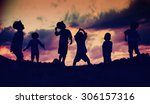 silhouettes of happy kids... | Shutterstock . vector #306157316