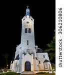 Small photo of Lutheran church at night, Jurmala, Latvia. Built in 1909 with traits of asymmetry and national Latvian romanticism style. Architect W. Bokslaf