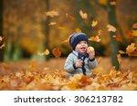 Cute Little Baby In Autumn Par...