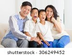 asian family sitting on sofa | Shutterstock . vector #306249452