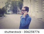a bearded man in a jacket and...   Shutterstock . vector #306258776
