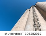 old high concrete  silo with...
