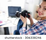 female photographer sitting on... | Shutterstock . vector #306338246