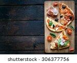 slices of mini pizza variety... | Shutterstock . vector #306377756