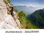 woman climbing on ferrata in...   Shutterstock . vector #30639499