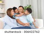 indoor portrait of asian family | Shutterstock . vector #306422762