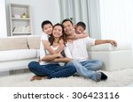 indoor portrait of asian mixed... | Shutterstock . vector #306423116