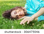 girl in the grass. beautiful... | Shutterstock . vector #306475046