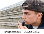 teenage boy smoking cigarette... | Shutterstock . vector #306552212